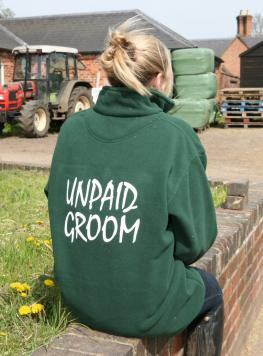 Bottle Green ¾ zip fleece with elasticated cuffs, large collar, zip up pockets and Unpaid Groom logo